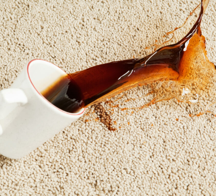 Coffee Spilling from Cup onto Carpet